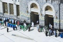 Pilgrims at The Gate of Al Haram of Al Kaaba in Mecca. Saudi Arabia royalty free stock photos
