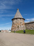 Pilgrims go by a tower of the Solovki monastery Stock Image