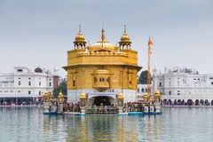 Pilgrims at the Golden Temple, the holiest Sikh gurdwara in the world. stock image
