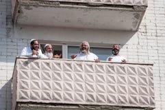 Pilgrims of Hasidi on the balcony of the high-rise building are having fun celebrating the holiday of Rosh-ha-Shana. Uman, Ukraine - September 21, 2017: Jewish stock photos