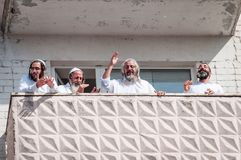 Pilgrims of Hasidi on the balcony of the high-rise building are having fun celebrating the holiday of Rosh-ha-Shana. Uman, Ukraine - September 21, 2017: Jewish royalty free stock image