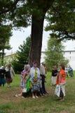 Pilgrims at healing cedar. Stock Photos