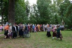 Pilgrims at healing cedar. Stock Photography