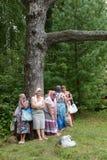 Pilgrims at healing cedar. Royalty Free Stock Photography