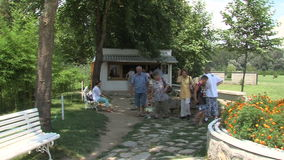Pilgrims from the holy spring in Rupite, Bulgaria stock video footage