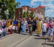 Pilgrims kneel in front of the miraculous icon. Ukraine. Kharkiv. July 10, 2016. Procession for peace. Icon of the Mother of God - the main shrine and the Royalty Free Stock Photo