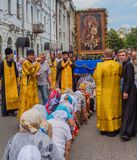 Pilgrims kneel in front of the miraculous icon. Ukraine. Kharkiv. July 10, 2016. Procession for peace. Icon of the Mother of God - the main shrine and the Royalty Free Stock Images