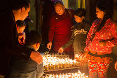 Pilgrims lighting up candles at Boudhanath stupa Royalty Free Stock Photography