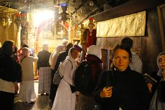 Pilgrims in The magnificent Basilica of Christ's Nativity in Bethlehem royalty free stock photos