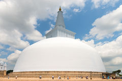 Pilgrims near white sacred stupa, Anuradhapura, Sri Lanka Royalty Free Stock Photo