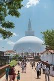 Pilgrims near white sacred stupa, Anuradhapura, Sri Lanka royalty free stock photos