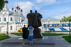 Pilgrims are photographed at monument of saints Peter and Fevron Stock Image