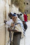Pilgrims pray at the wall of the weeping of the holy place of the Jewish people and the center of worship of Christians around the Stock Photo