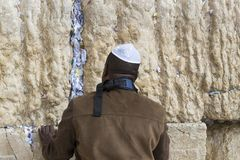 Pilgrims pray at the wall of the weeping of the holy place of the Jewish people and the center of worship of Christians around the Royalty Free Stock Photo