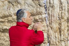 Pilgrims pray at the wall of the weeping of the holy place of the Jewish people and the center of worship of Christians around the Royalty Free Stock Images