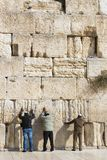 Pilgrims pray at the wall of the weeping of the holy place of the Jewish people and the center of worship of Christians around the. JERUSALEM, ISRAEL - 22 Royalty Free Stock Photo