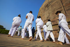 Pilgrims praying at the Buddhist Stupa Royalty Free Stock Images