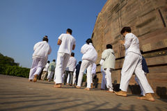 Pilgrims praying at the Buddhist Stupa in Sarnath Royalty Free Stock Images