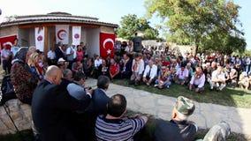Pilgrims praying at the grave of Sari Saltik Baba stock video footage