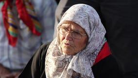 Pilgrims praying at the grave of Sari Saltik Baba stock video
