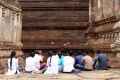 Pilgrims praying at Rankoth Vehera around Polonnaruwa Ancient Ci stock photography