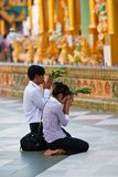 Pilgrims praying at Shwedagon Paya in Yangon, Myanmar Stock Images