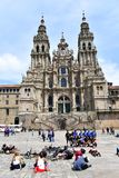 Pilgrims resting and taking pictures at Plaza del Obradoiro in front of the Cathedral. Santiago de Compostela, Spain, 5 May 2019. royalty free stock photos