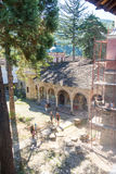 Pilgrims and restorers in the old Troyan Monastery in Bulgaria stock photography