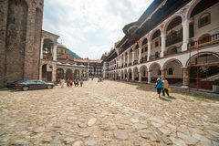 Pilgrims in the Rila Monastery in Bulgaria Stock Photography