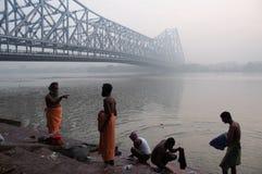 Pilgrims at river Ganges under Howrah bridge Royalty Free Stock Photography