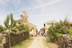 Pilgrims on the road to Santiago de Compostela in Santa Catalina de Samoza Stock Photo