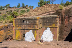 Pilgrims sitting in front of the Saint George church in Lalibela Stock Images