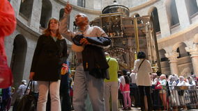 Pilgrims at the Stone Rotunda and Aedicule at the Church of the Resurrection in Jerusalem, Israel stock footage