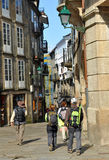 Pilgrims in the streets of Santiago de Compostela, Spain Royalty Free Stock Photos
