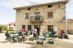 Pilgrims take a break at a bar on the way to Santiago de Compostela Stock Photo