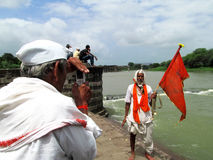 Pilgrims taking photo. Its photo of pilgrims at the bank of indrayani river at dehu village in India stock photo
