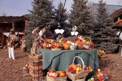 Pilgrims at Thanksgiving table Royalty Free Stock Photography