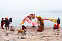 Pilgrims in Varanasi, India. VARANASI, UTTAR PRADESH, INDIA - JANUARY 13: Unidentified hindu pilgrims dry their saris after bathing in the sacred Ganges river at royalty free stock photography