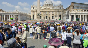 Pilgrims in Vatican City. VATICAN CITY - JUNE 5: pilgrims and tourists in Saint Peter's Square for a Papal audience on June 5, 2013 in Vatican City. Pope Francis Stock Image