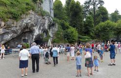 Pilgrims visiting the cave at Massabielle Royalty Free Stock Photo