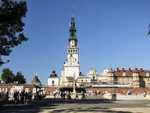 General view on square at Jasna Gora Monastery in Czestochowa in Poland. Pilgrims visiting the Jasna Gora. Many people seen from behind or walking. Photo taken Royalty Free Stock Image