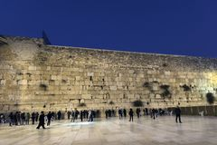 Pilgrims visiting the Wailing Wall in Jerusalem, Israel, Middle East. The Wailing Wall forms part of the western perimeter wall of the Herodian Temple plateau royalty free stock photo