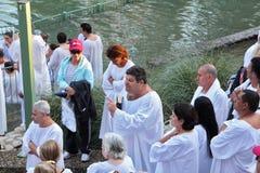 Pilgrims waiting his turn in  white christening shirt. Royalty Free Stock Images