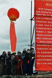 pilgrims are waiting next to a large chinese sign during a governmental announcement royalty free stock image