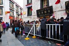 Pilgrims waiting outside Jokhang Stock Images