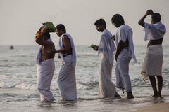 Pilgrims walk down to the sea to offer puja Royalty Free Stock Images
