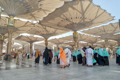 Pilgrims walk underneath giant umbrellas at Nabawi Mosque Royalty Free Stock Photography