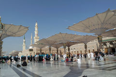 Pilgrims walk underneath giant umbrellas at Nabawi Mosque Royalty Free Stock Images