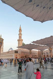 Pilgrims walk underneath giant umbrellas at Nabawi Mosque Royalty Free Stock Photo