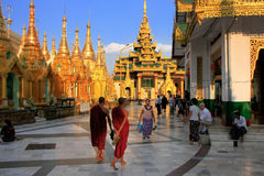 Pilgrims walking around Temples of Shwedagon Pagoda complex, Yan Royalty Free Stock Images